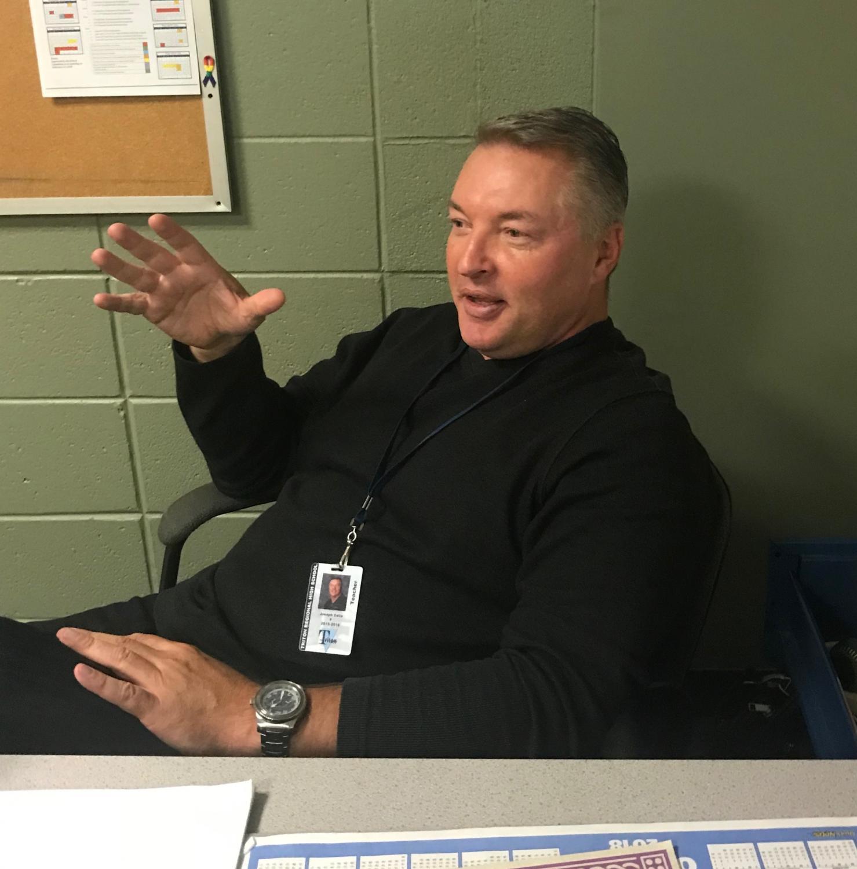 Teacher Joe Celia speaks with a student
