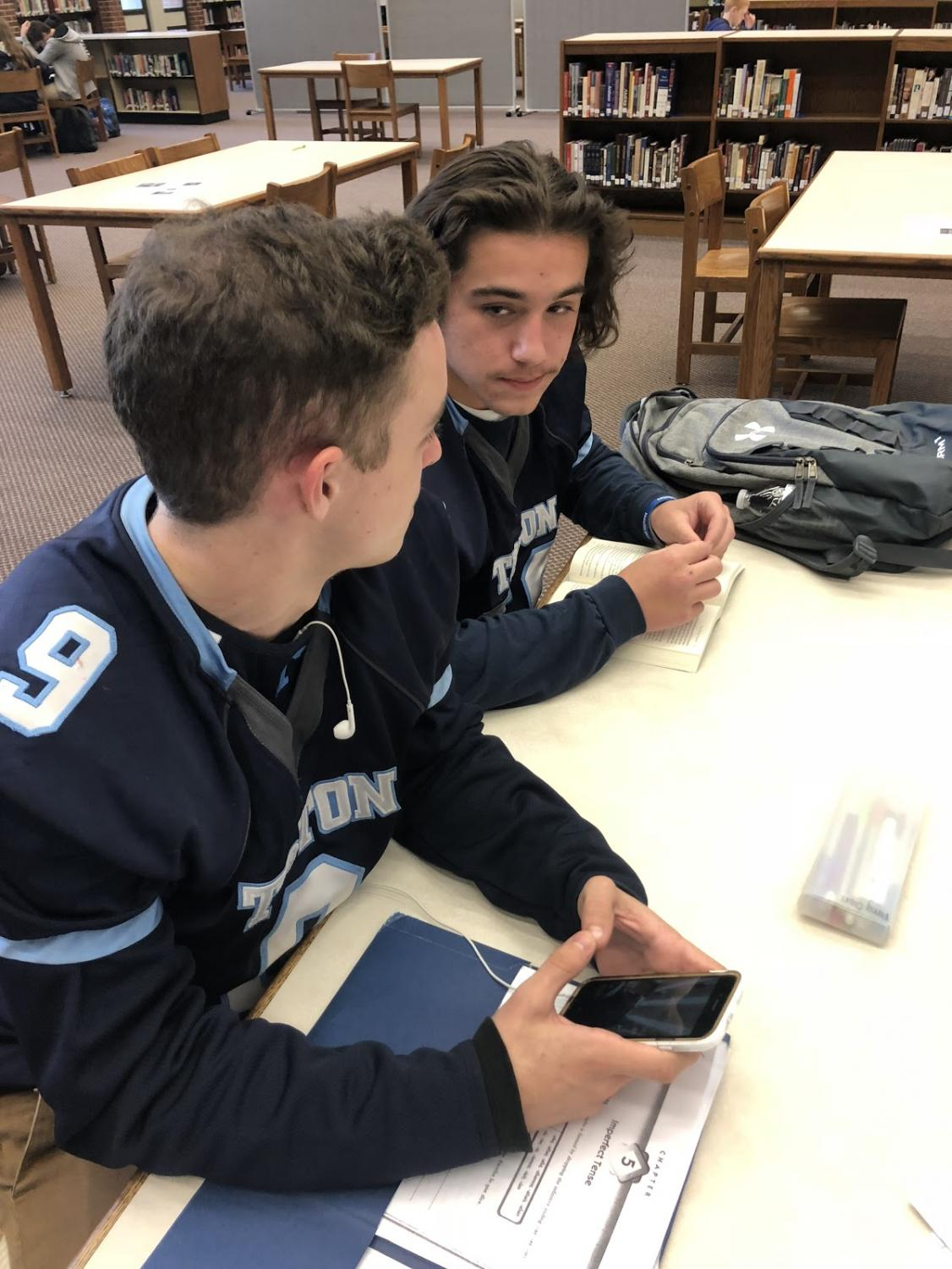 Triton Regional High School students Jack Crocker (left) and Jon Rolfe (right) discussing Brett Kavanaugh.