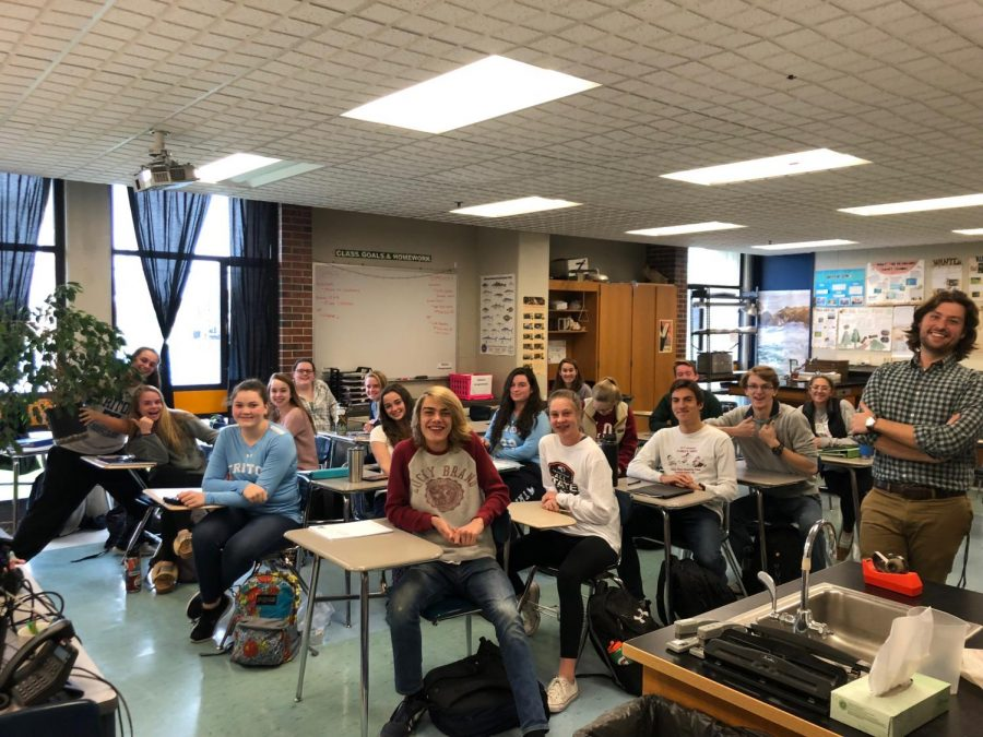 Horsley stands on the right with his enthusiastic AP Students behind him.