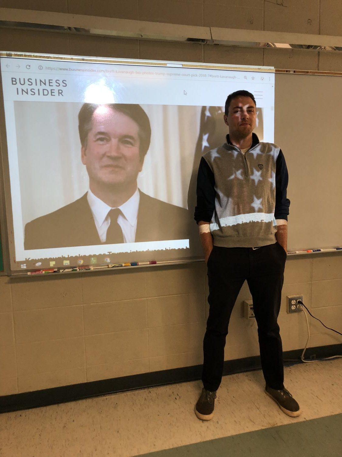 Mr. Galante stands before a projected image of Supreme Court Justice Brett Kavanaugh.