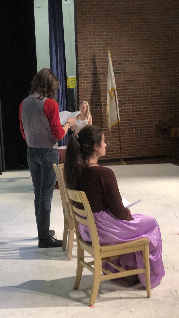 Students Madison Butler, Olivia Valley, and Jonathan Woodbury practice for an upcoming theatrical production.