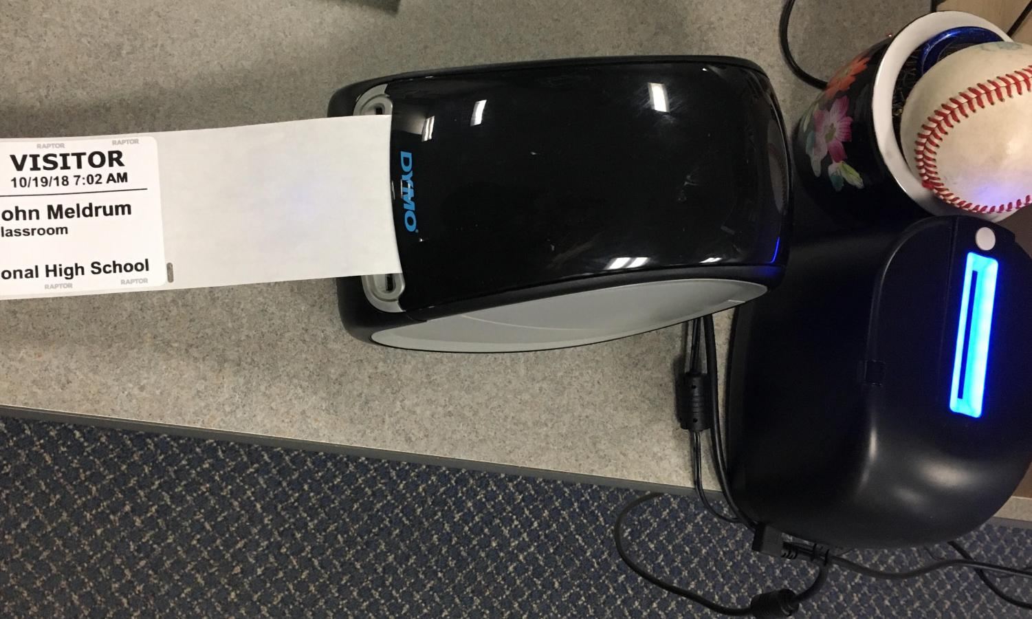 The Raptor ID scanner and badge printer on Kimberly Wright's desk