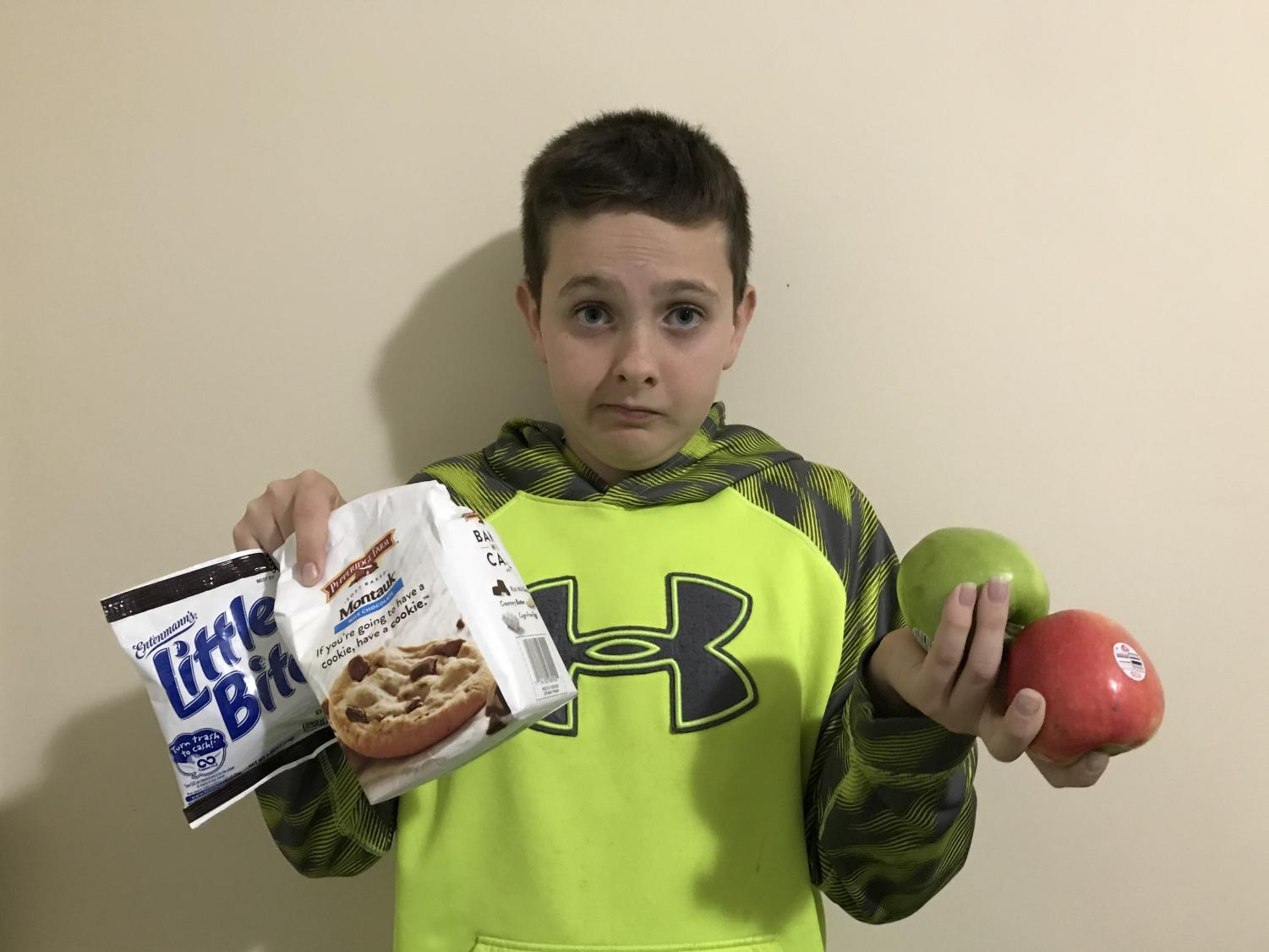 Student has trouble deciding if he should have a healthy snack or not