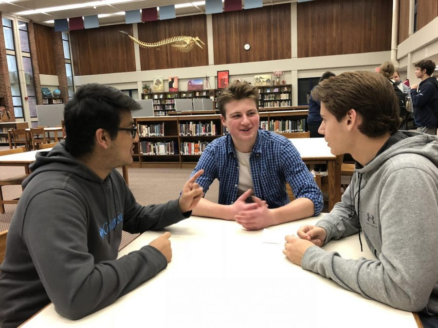 (From left to right) Tirth Patel, Justin Szymanski, and Kyle Brancaleone talk about the I.N.F Treaty. (Lind Photo)