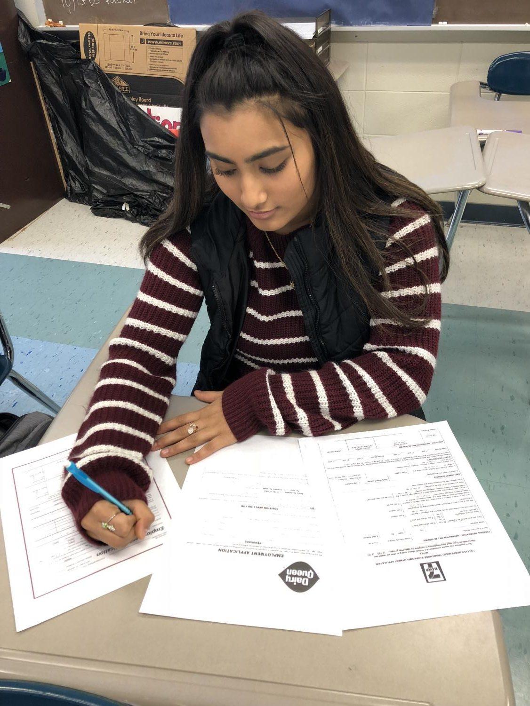 Triton student fills out job applications.
