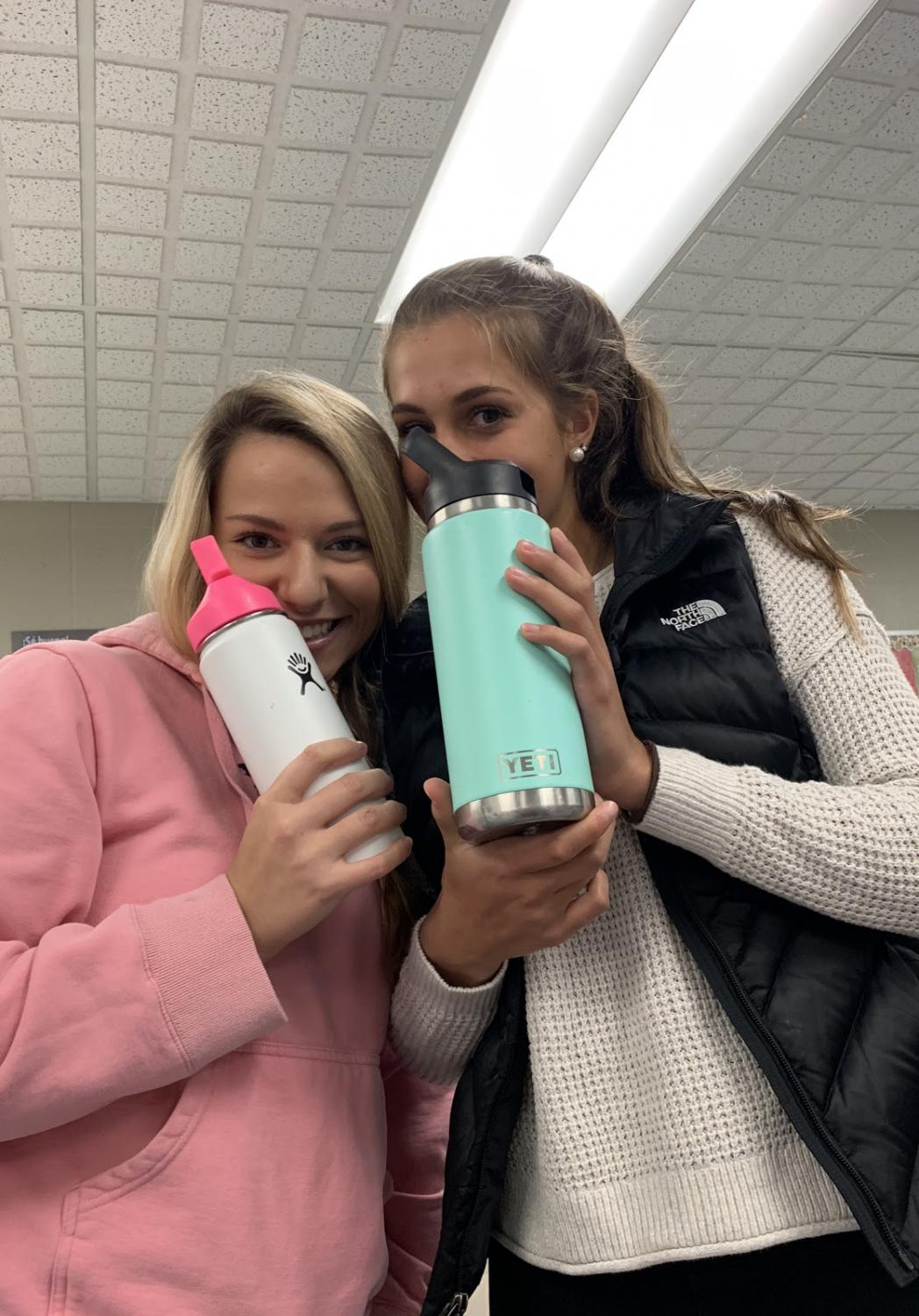 Photo of Gianna Conte (Right) and Kaia Cohen (Left) holding their Hydro Flask and Yeti.