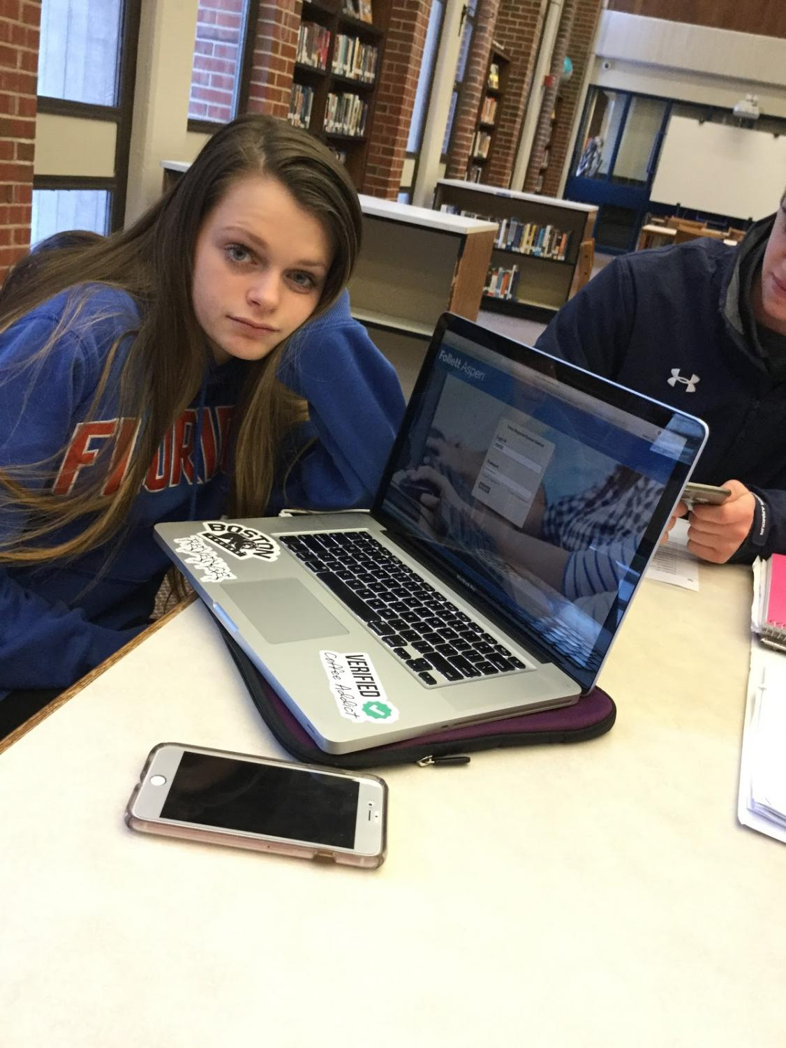 Junior Abbie Magee sits nervously in anticipation of checking her Aspen grades.