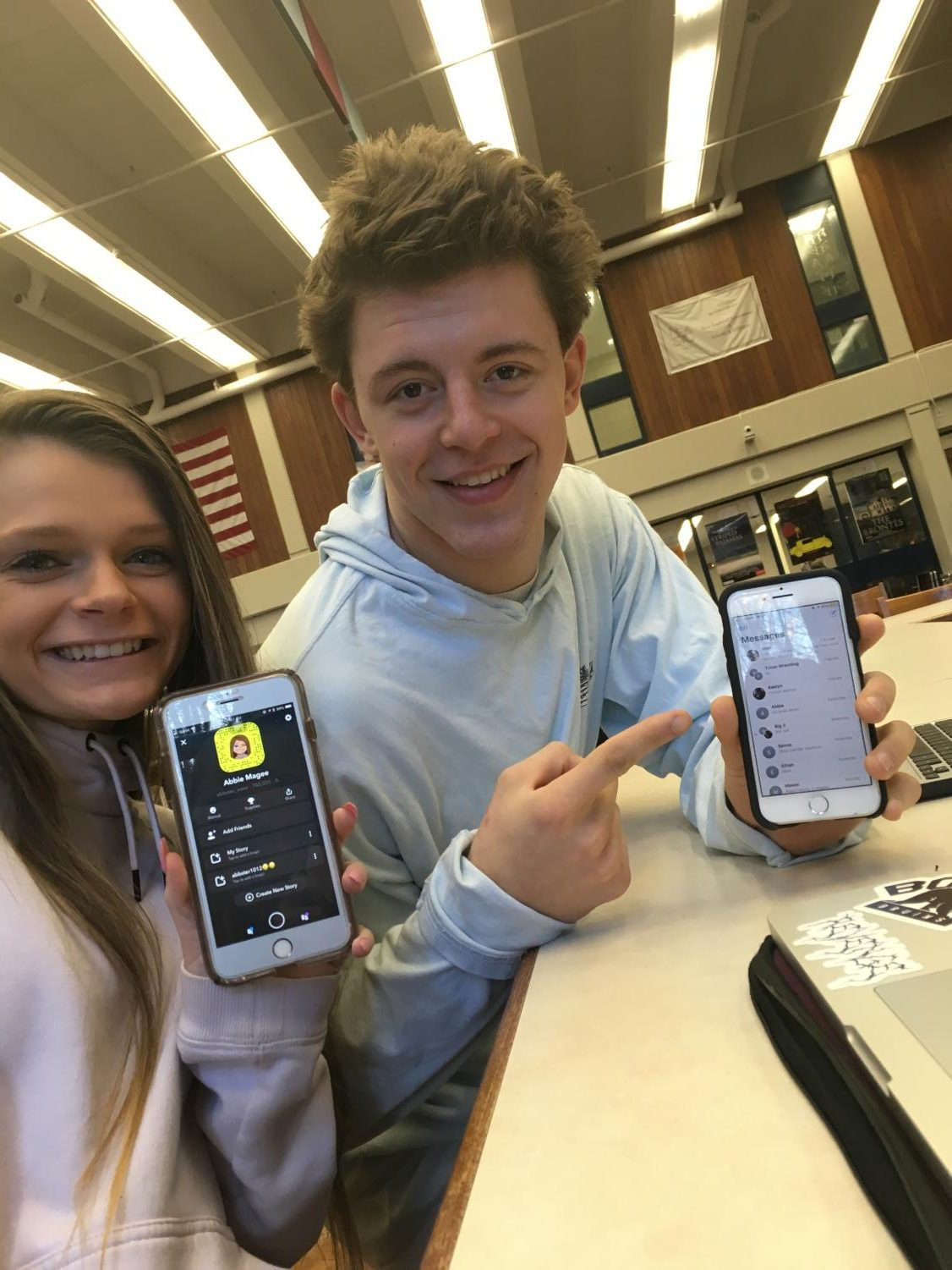 Juniors Abbie Magee (holding up Snapchat) and Anthony Ostrander (holding up iMessage)