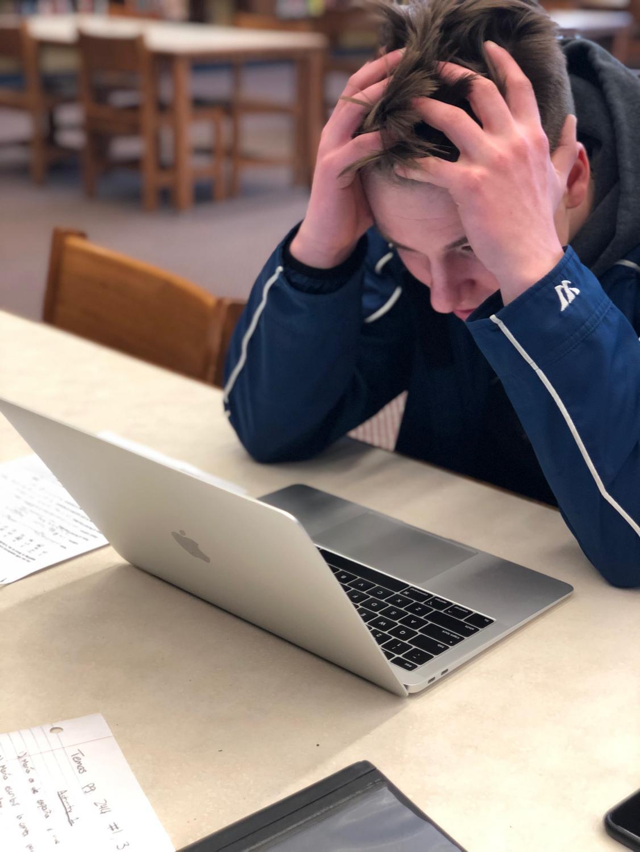 Senior Justin Szymanski stresses over Aspen as he attempts to check his grades.