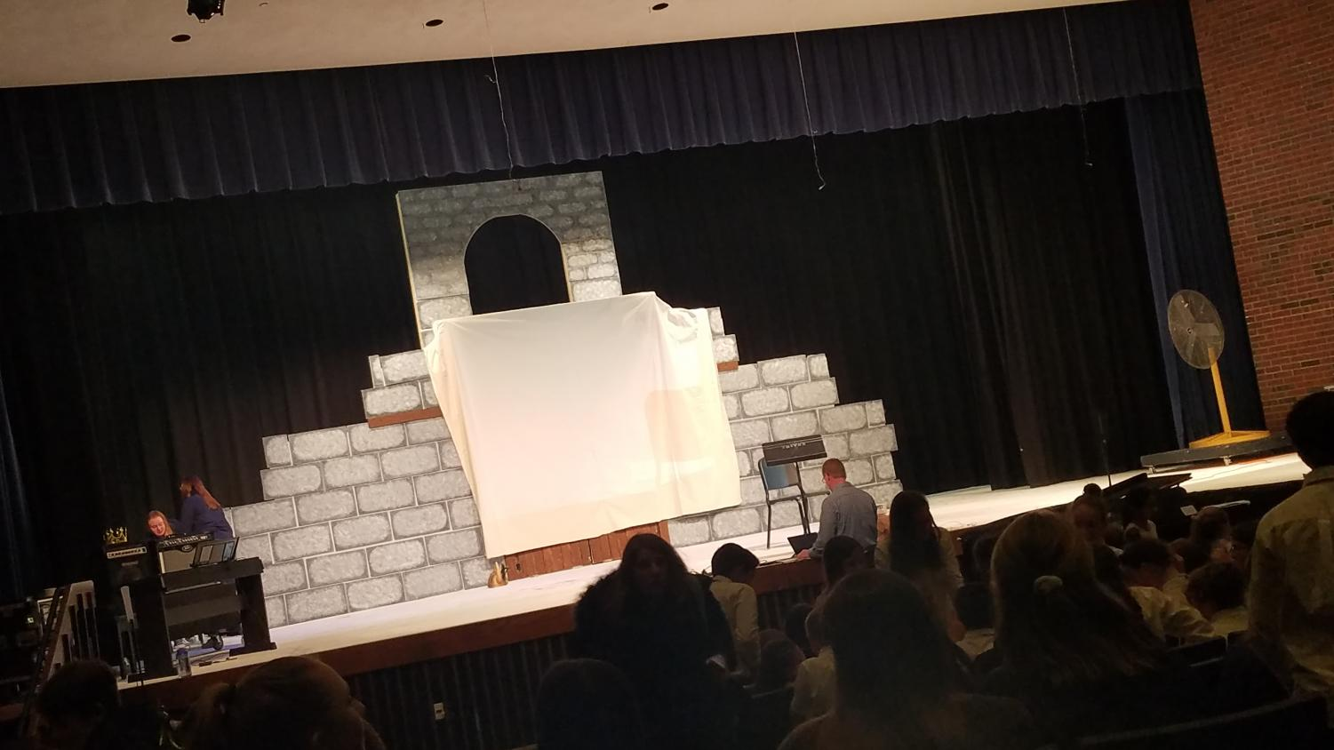 The+screen+for+karaoke+was+placed+in+%27Spamalot%27s%27+castle+themed+set.
