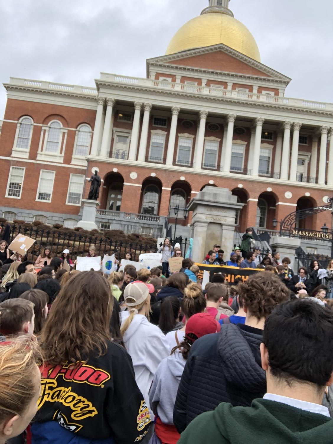 Students protest in front of the State House in Boston on March 15 to protest humans' participation in Global Climate Change.