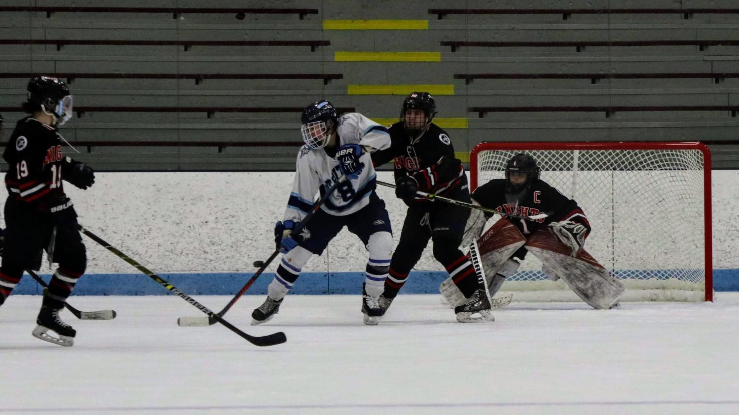 Junior Jack Niska battles for the tip in front of North Andover's net.