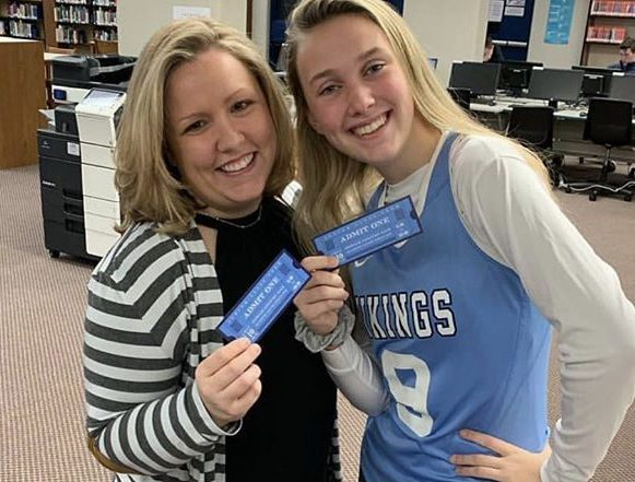 (Photo Courtesy of THSjuniorprom instagram account)   Junior Class Officer Paige Volpone and Junior Class Advisor Theresa Carol pose with prom tickets reminding junior to get their tickets before the deadline.