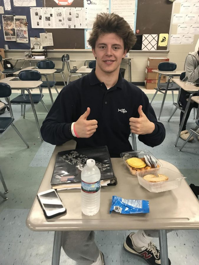 Anthony+Ostrander+eating+his+daily+sausage%2C+egg%2C+and+cheese+sandwich+during+third+period.+