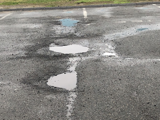A picture of the faculty parking lot here at Triton. Filled with potholes, bumps, and dangers for new drivers that don't know the lot.