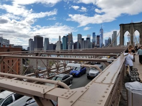 The view of New York City as seen from the Brooklyn Bridge.