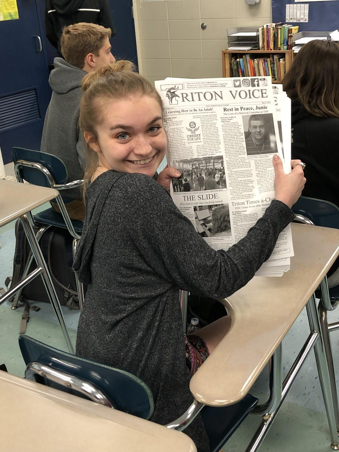 Bridget Tucker preparing to deliver the weekly newspaper to the neighboring Triton classrooms