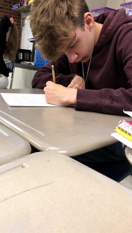Kiefer Callewaert taking a grammar quiz that was given by his classmate Alex Micals