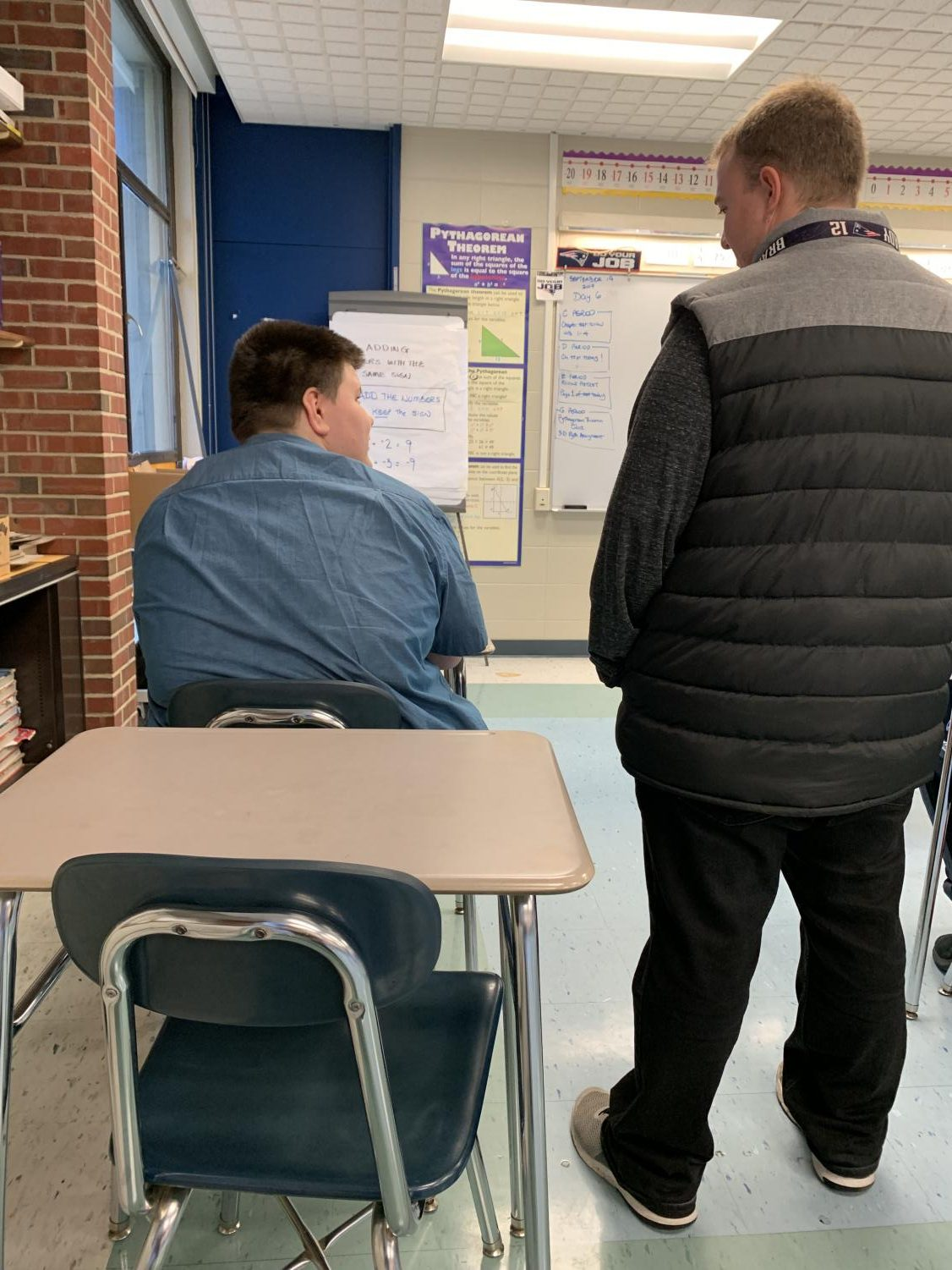 Mr. Lozzi working with one of his students during math.
