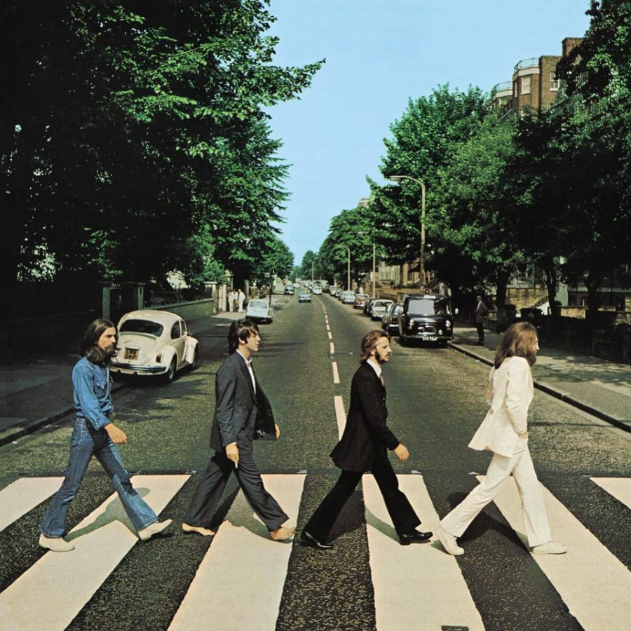 The iconic Abbey Road album cover featuring the four band members crossing Abbey Road.