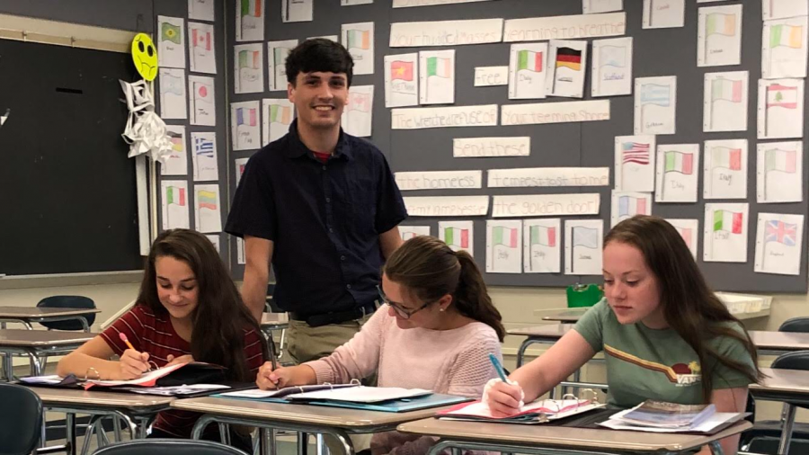 Mr. Zerega working with three students in the Middle School classroom (Conell Photo)