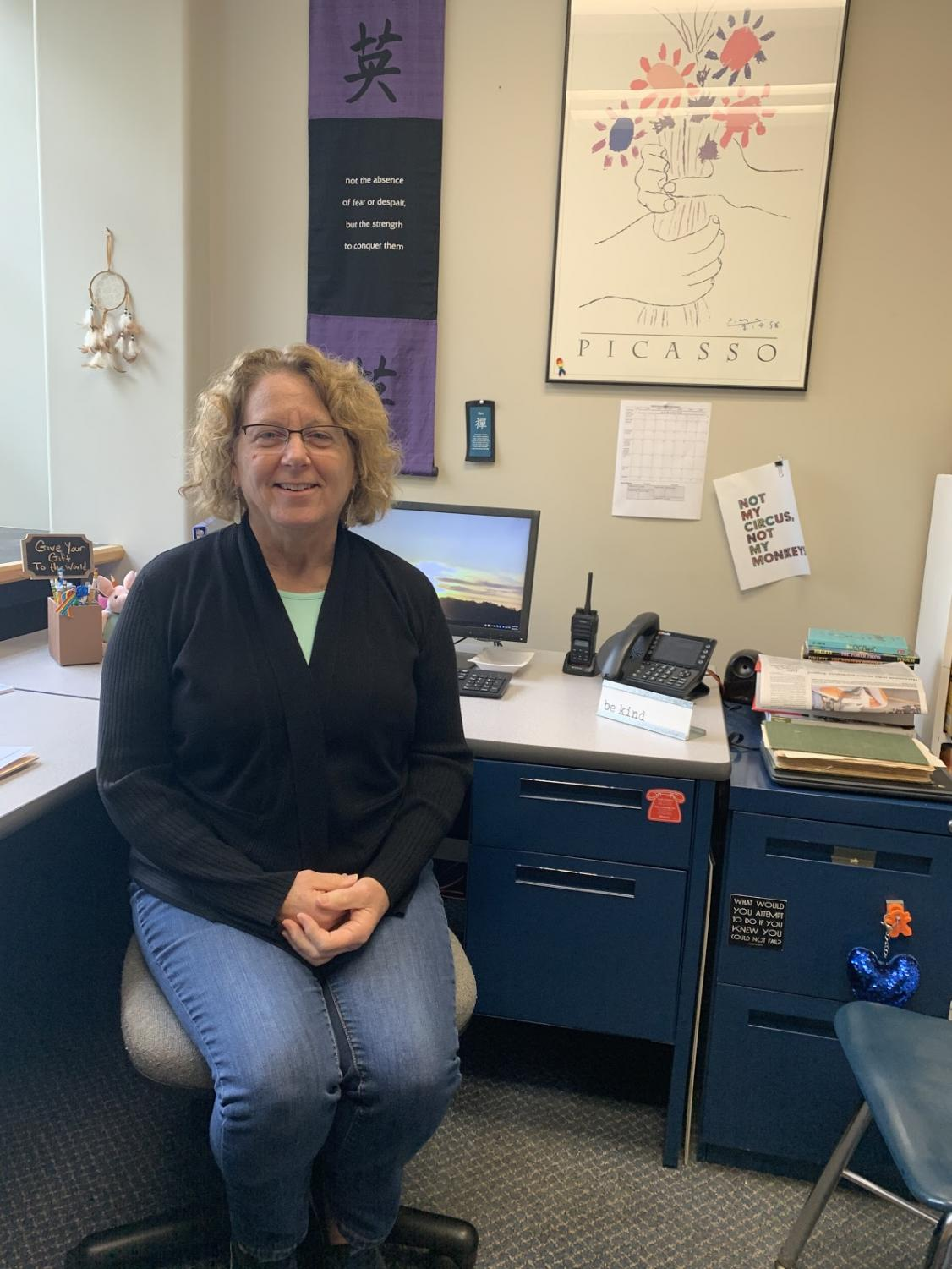 Mrs. Nancy Tsakirgis reflects on 25 years in the district in her office in the Middle School