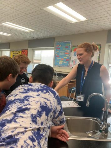 Mrs. Sheahan helping a group of her 7th grade Biology students.