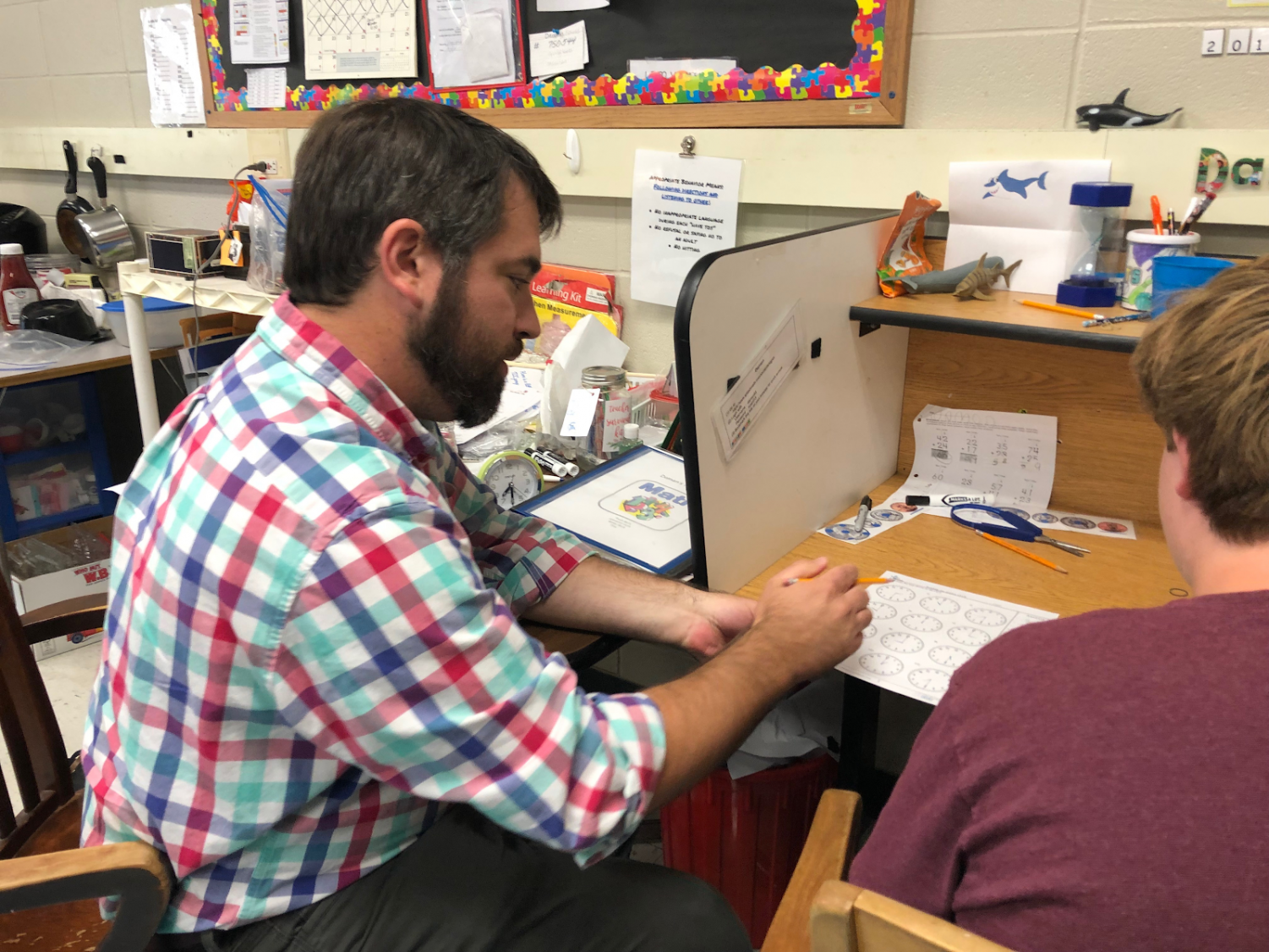 Here is Mr. Swartz helping his student with a worksheet.
