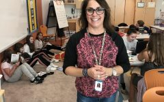 Mrs. Max poses in front of students hard at work on a Friday afternoon