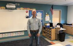 Kindergarten teacher Mr.Paul White stands in his new Pine Grove classroom.
