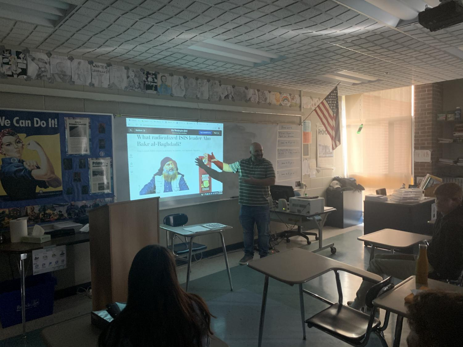 Mr. Chad Richard teaches a lesson his U.S. history class about the death of Al-Baghdadi