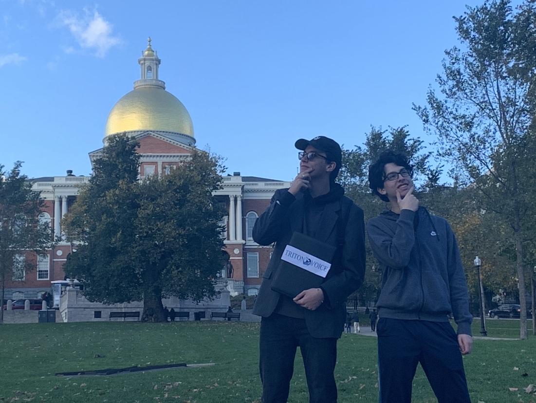 Staff Writers Timmy Timmons and Miguel Gigandet pose with the Massachusetts State House.