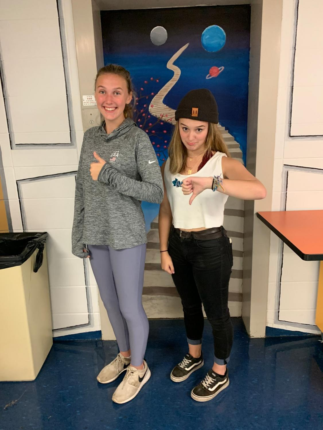 Triton High School Seniors Paige Volpone and Amanda Ouellette showing the difference between an appropriate outfit and not appropriate outfit. Photo courtesy of Cameren Jolivet