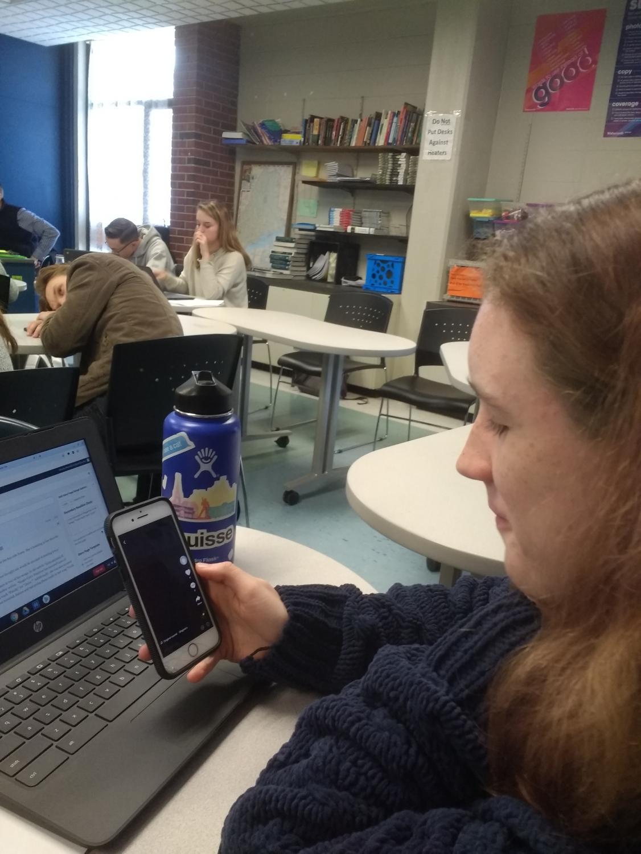 Marcella Hubbard-Brucher looking at a censored Tik Tok post.