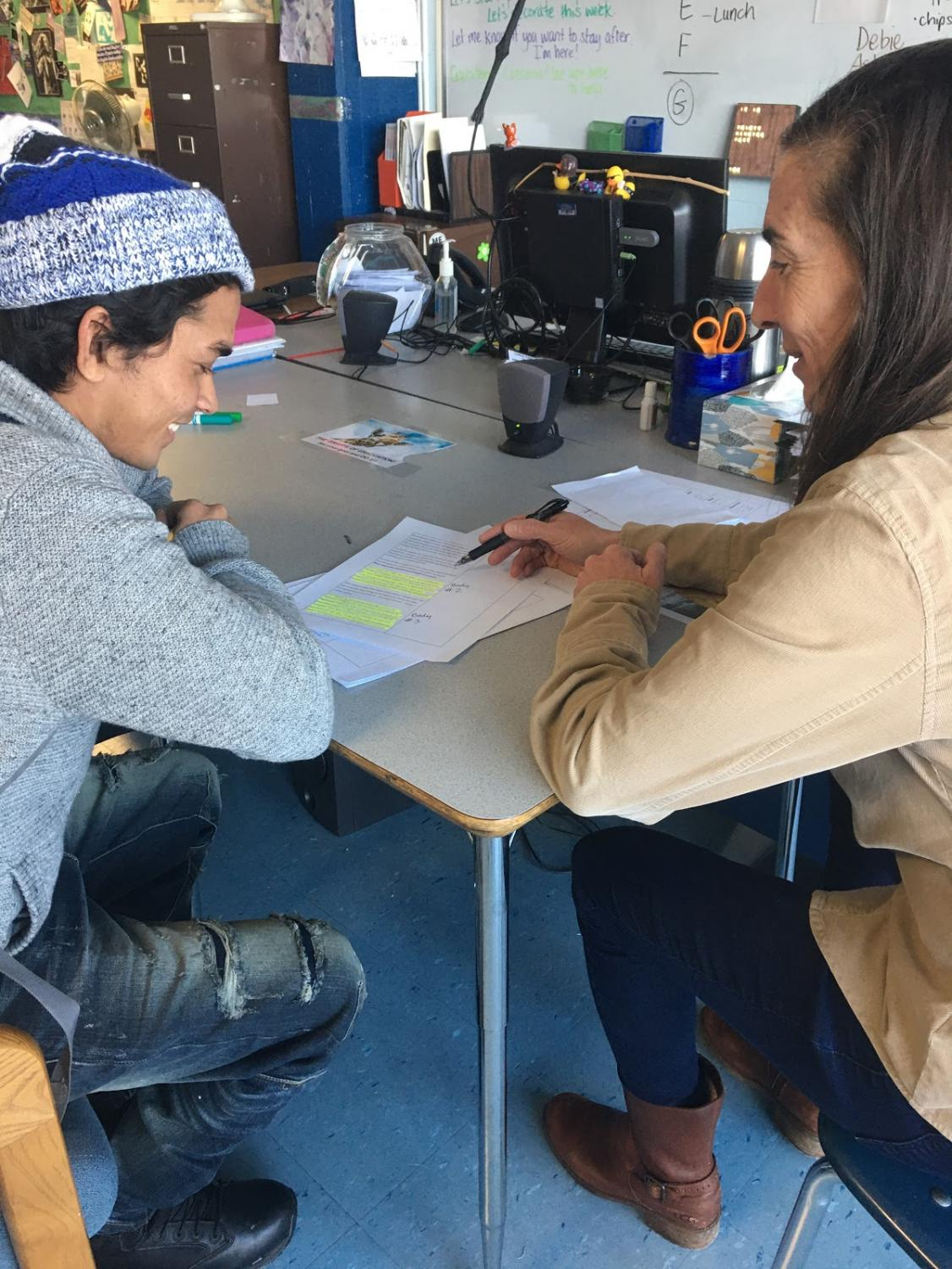 Carla Wagner, academic support teacher, hard at work teaching Robi Ullah on a Thursday afternoon.