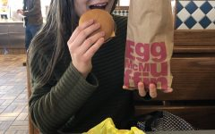 Junior Ana Barona enjoying a cheeseburger from McDonalds, photo taken by Andrew Babine.
