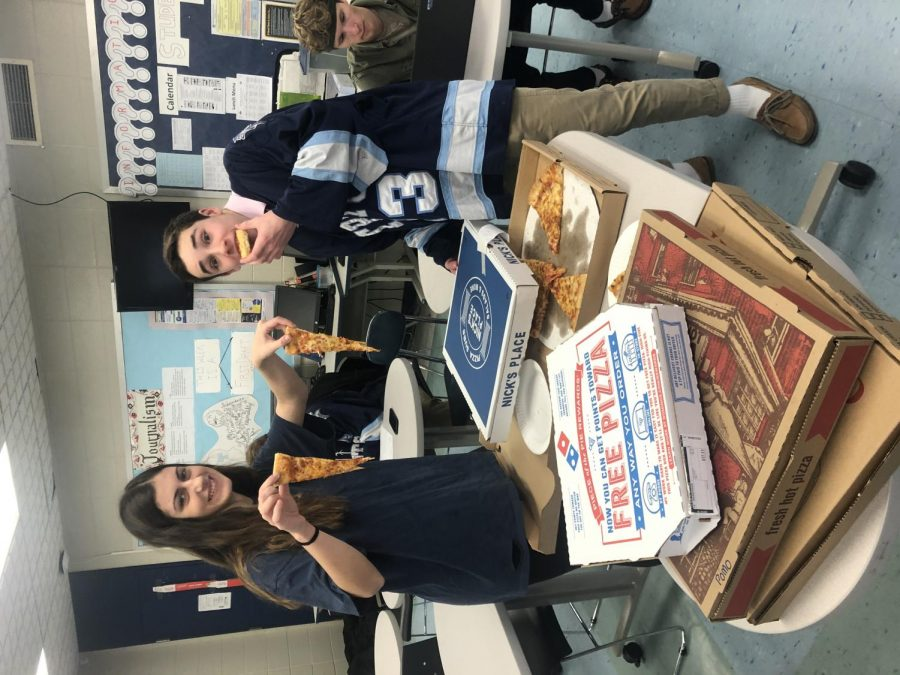 Juniors James Tatro and Kyla Prussman take bites of five different pizzas.