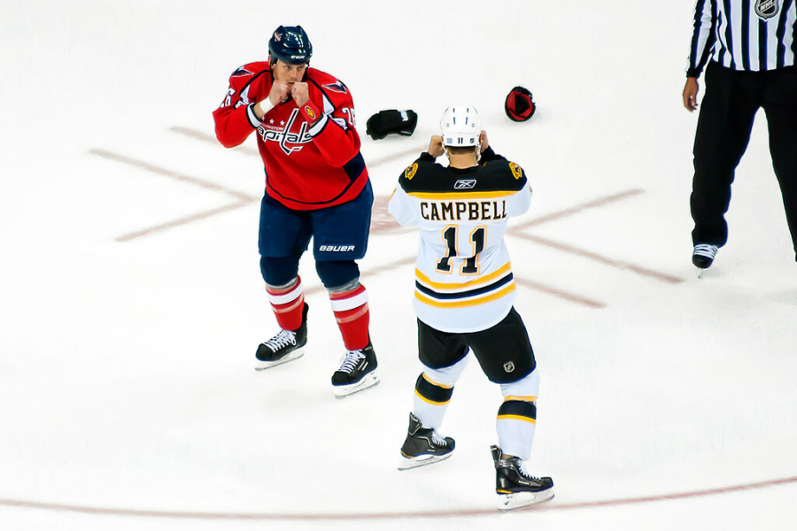 Gregory Campbell (11), squares off with fellow enforcer Matt Hendricks (26). (Creative Commons)