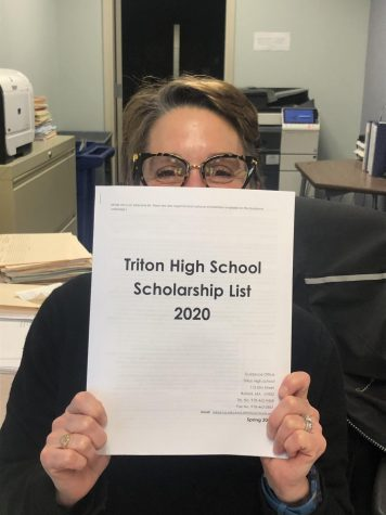Ms. Piecewicz holds up the 2020 scholarship packet.