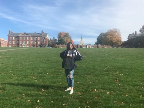 Photographed is Sammie Marinello in front of the Bucknell University campus