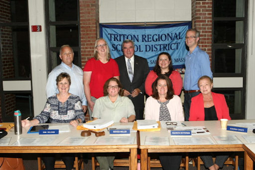 the Triton Regional School district committee poses during a recent school meeting