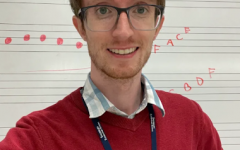 Mr. McConnell in front of his whiteboard, in the Salisbury Elementary music room.