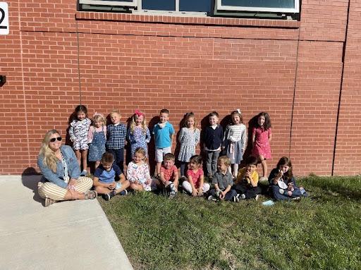 Ms. Fellows and her kindergarten students, in front of Pine Grove School.
