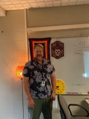 Michael Vanderslice in front of some of his favorite decorations in his classroom.