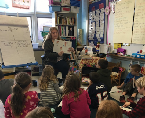 Kylie Orzulak reads students a story during story time prior to the pandemic.
